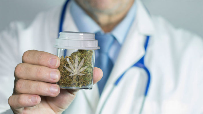 Doctor holding a jar of weed keeping it fresh